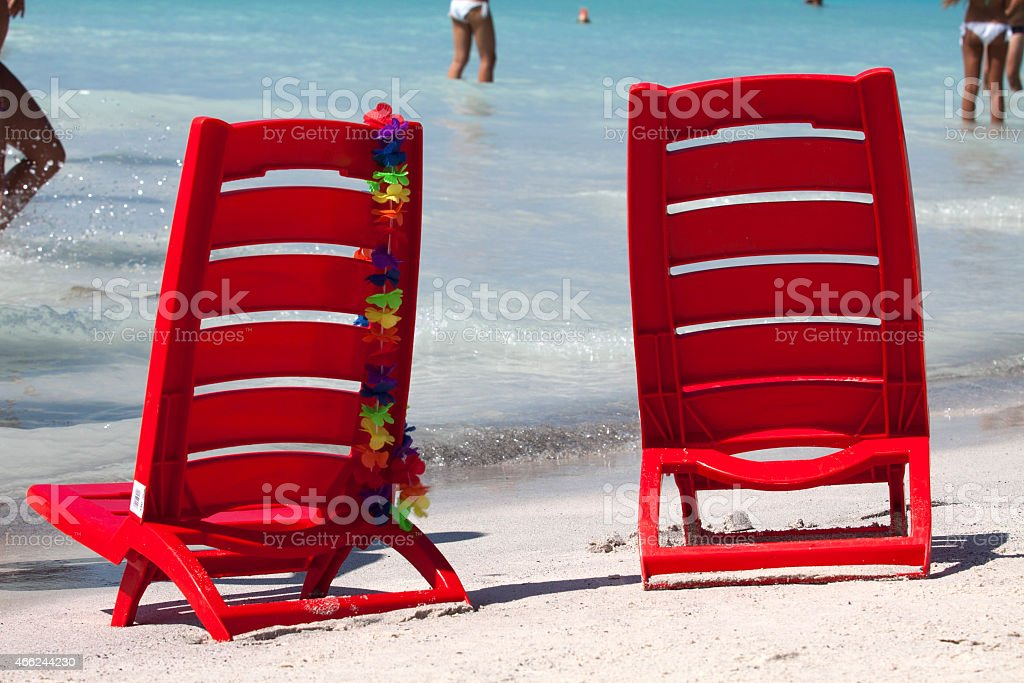 Red chairs by the sea stock photo