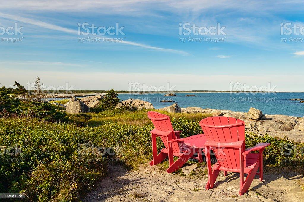 Red chairs facing Keji Seaside beach stock photo