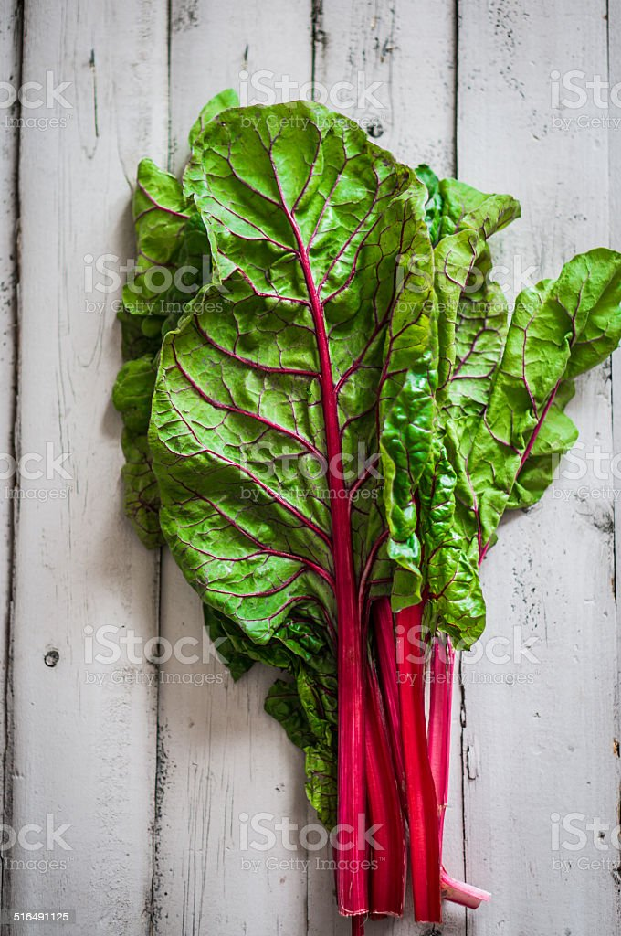 red chard on wooden background stock photo