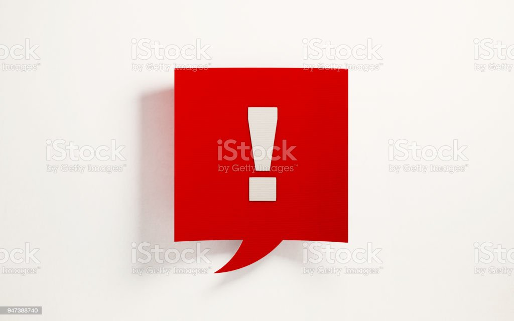Red Chat Bubble With Exclamation Point On White Background stock photo