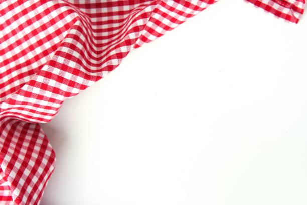rote checkere kleidung auf weißen tisch leeren raum hintergrund. - klapprahmen stock-fotos und bilder