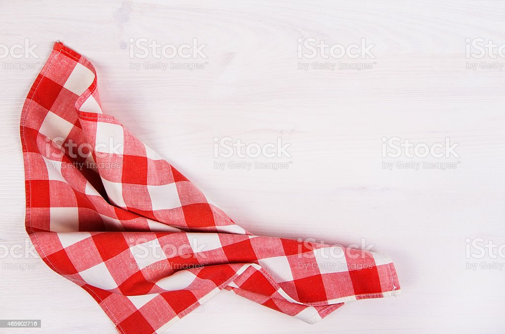 Red checkered napkin against white background stock photo
