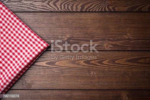 istock Red checkered tablecloth 700110274