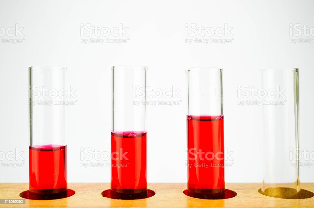 Red chemical in test tubes stock photo