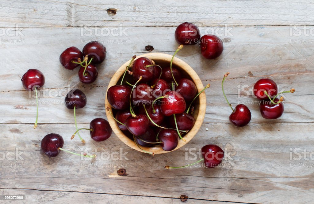 Red cherries in a bowl stock photo