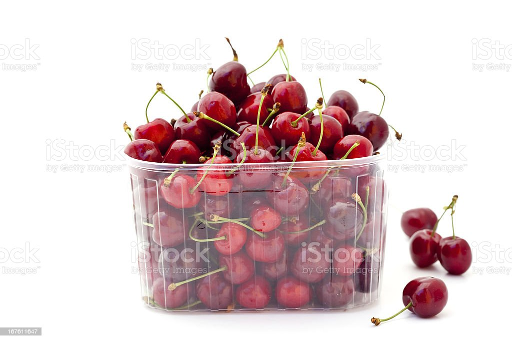 red cherries in plastic container royalty-free stock photo