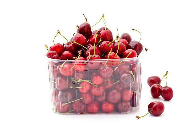 red cherries in plastic container stock photo