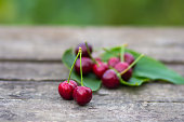 an image of red cherry fruits on wooden table background