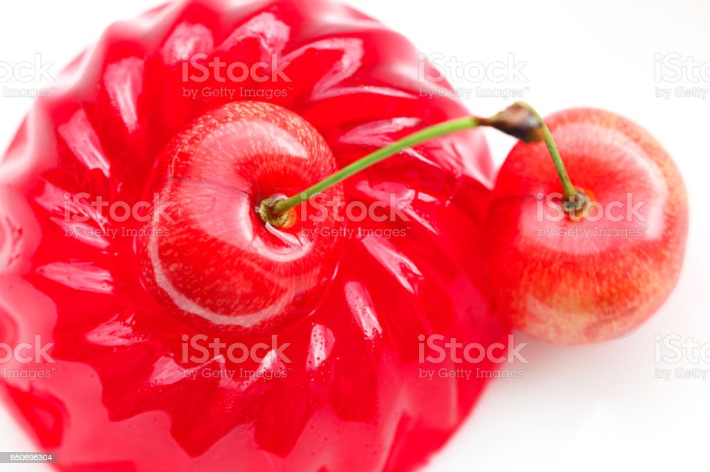 Red cherry jelly with cherry  on white background stock photo