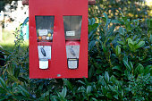 Red Chewing gum machine with sweets