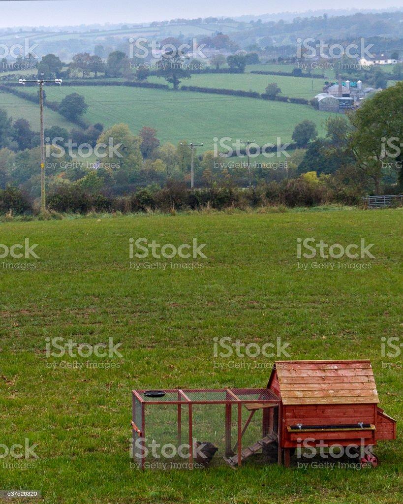 Red Chicken Coop in rural Northern Ireland farmland stock photo