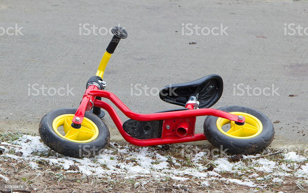 Red childrens balance bicycle stock photo
