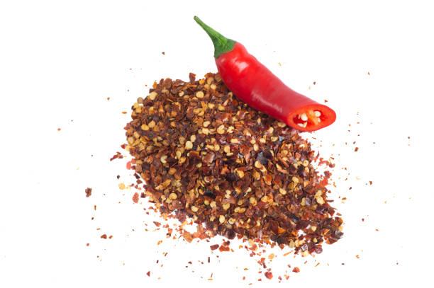 Röd Chili frukt och Chili flingor bildbanksfoto