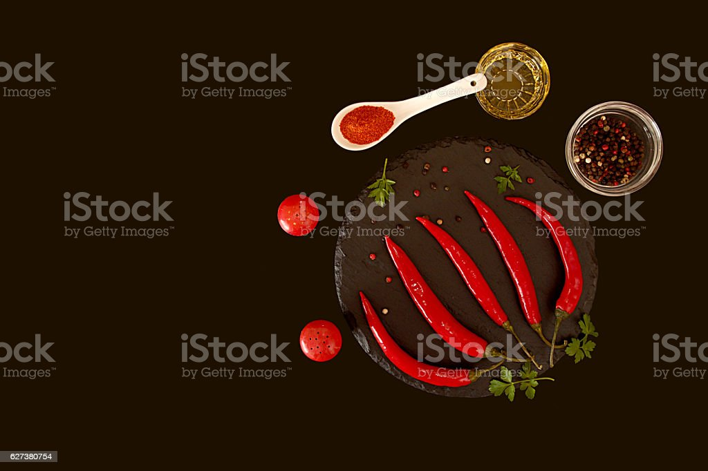 Red chili pepper on black background. Composition of group chili stock photo