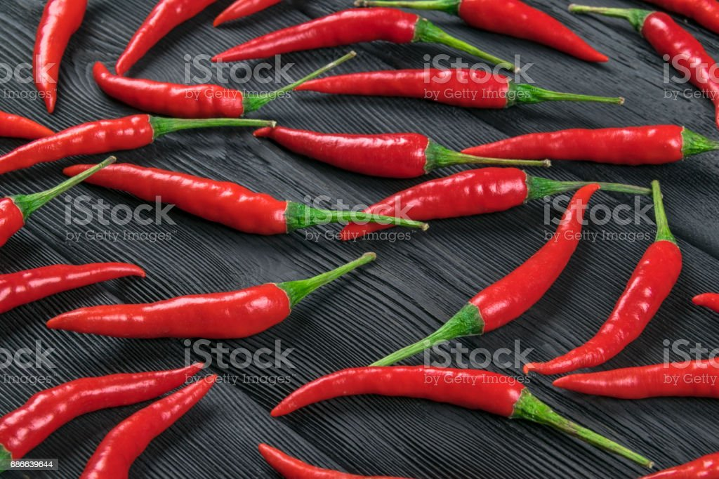 Red chili pepper on the dark wood background royalty-free stock photo