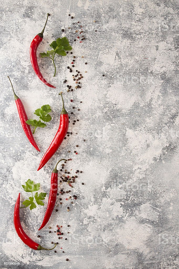 Red chili pepper on white-black background. Composition of group stock photo