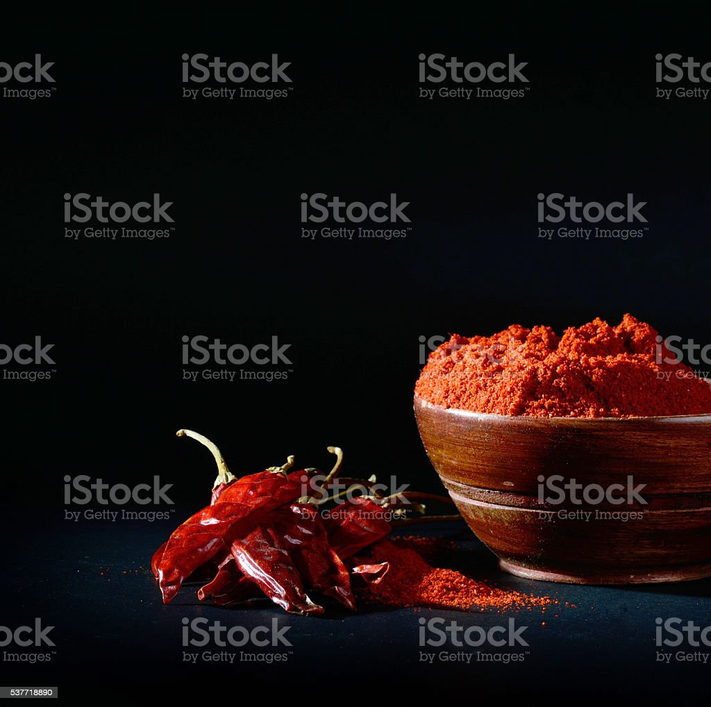 Red Chili Pepper powder and dried chili on black background stock photo