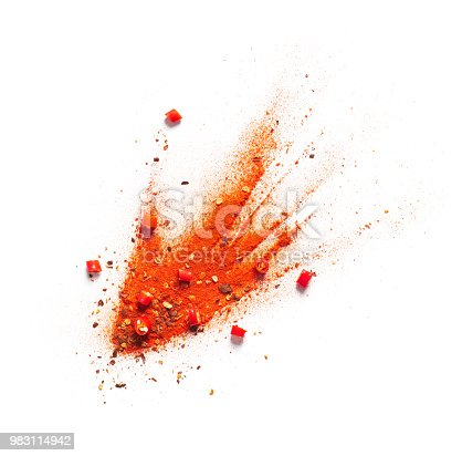 Red chili pepper, powder and flakes burst