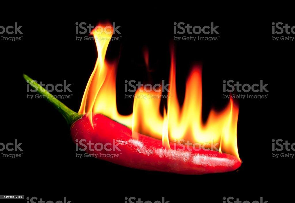 Red chili pepper with fire - Foto stock royalty-free di Alimentazione sana