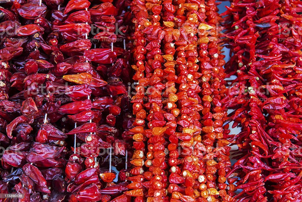 Red chili peppers drying outdoors stock photo