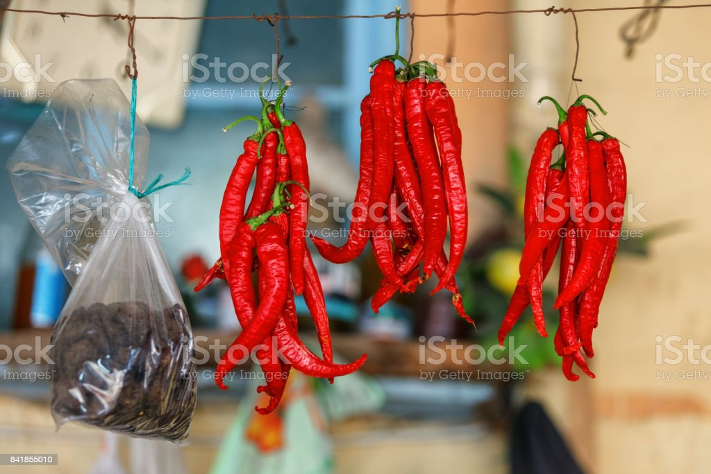 Red Chili Peppers hanging outdoor in the market stock photo