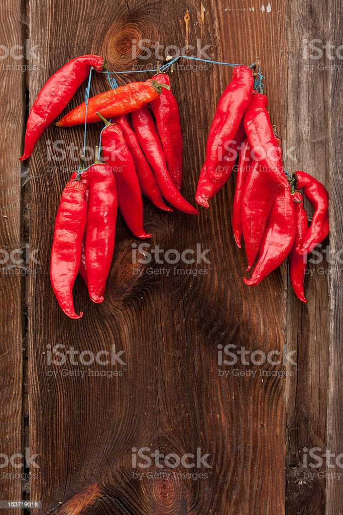 Red Chili Peppers hanging stock photo