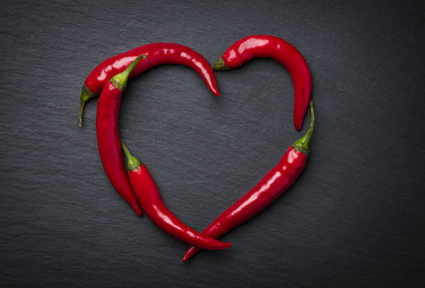 Red chili peppers heart for valentine's day. stock photo