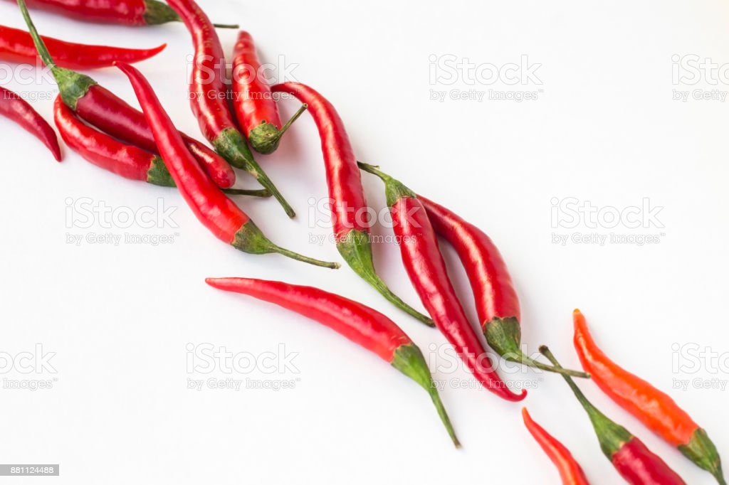 Red chili peppers on a white background diagonally. Top view. Horizontally stock photo