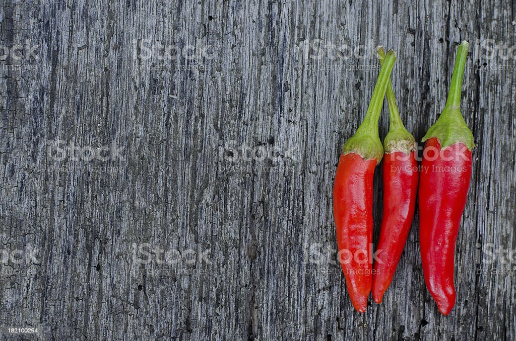 Red chili peppers on an old wooden background royalty-free stock photo