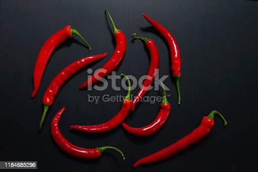 Red hot chili peppers on black backdrop