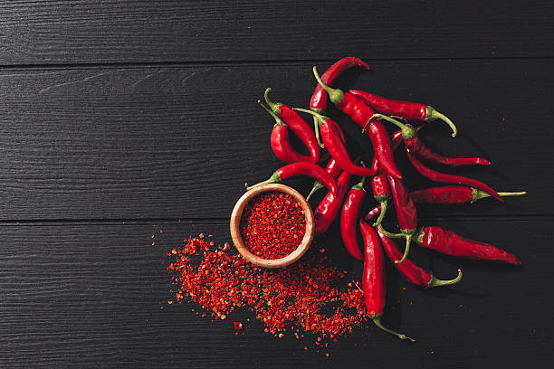 red chili peppers - chilli stock photos and pictures
