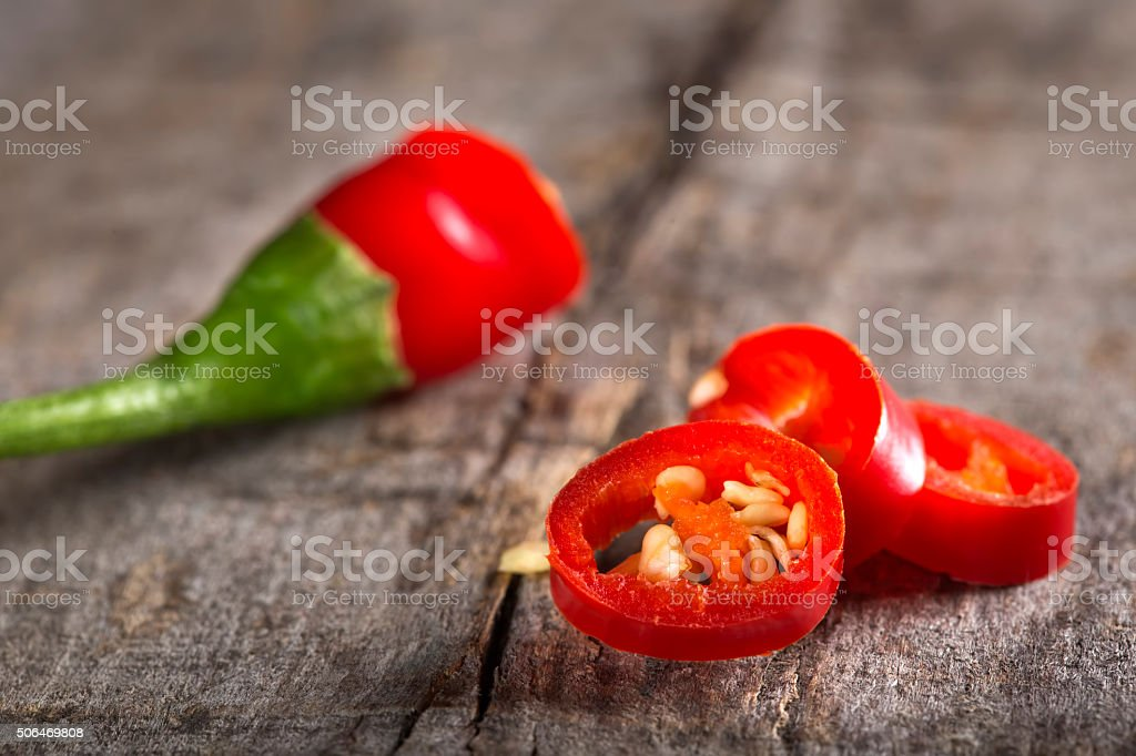 Red chili peppers slices stock photo