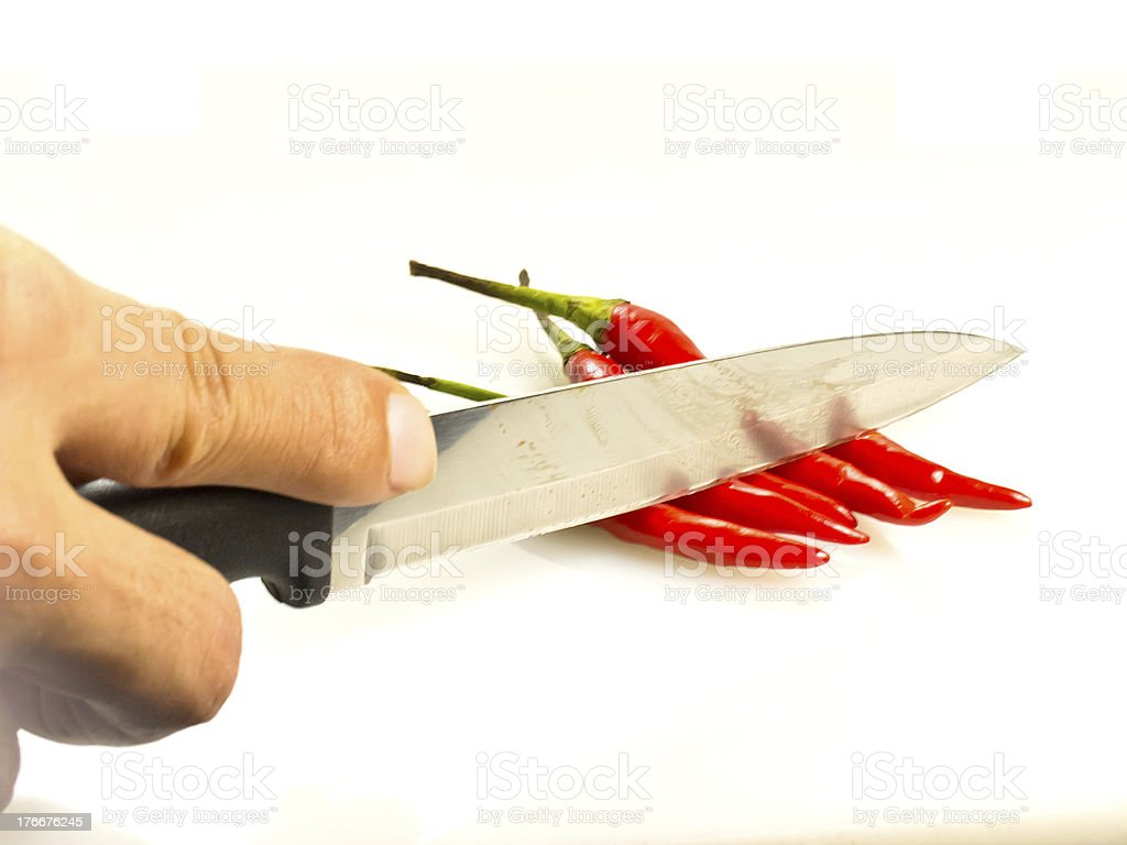 Red Chili peppers with hand of someone and knife royalty-free stock photo