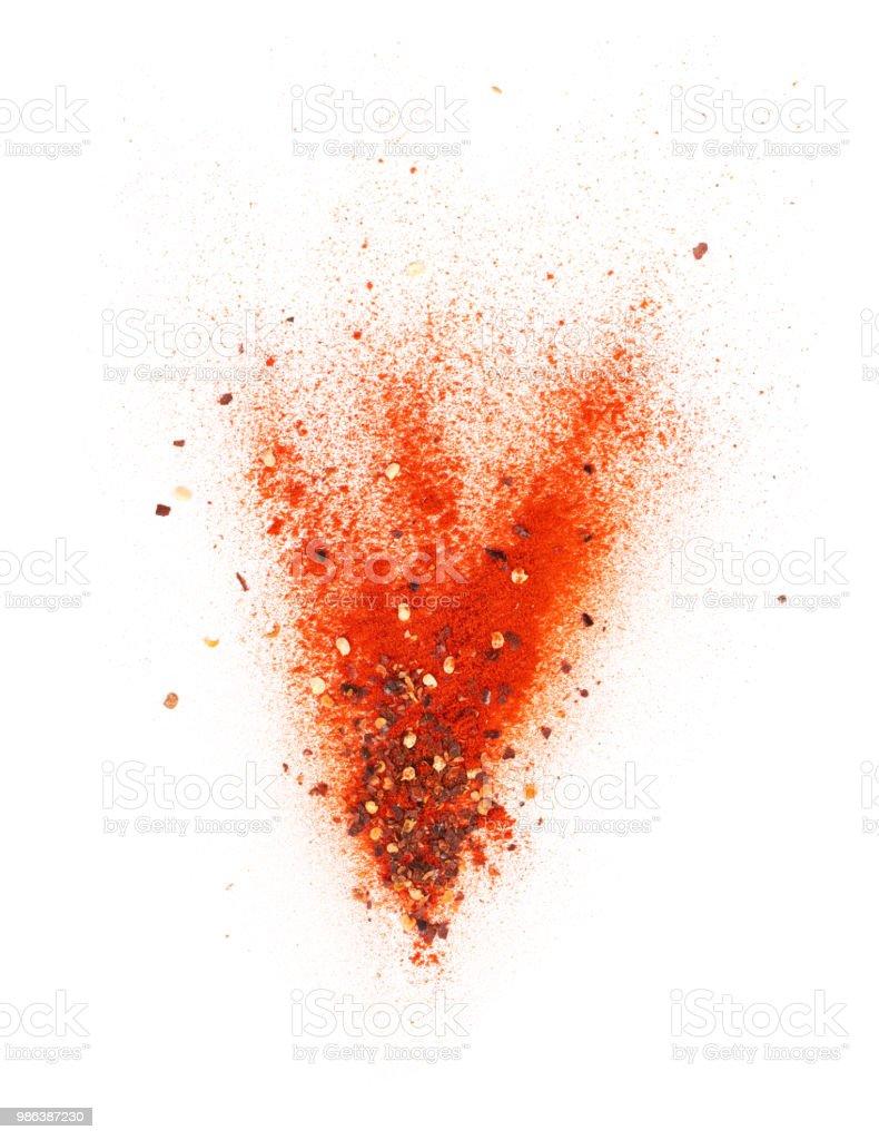 Ráfaga de copos de chili en polvo y Chile rojo foto de stock libre de derechos