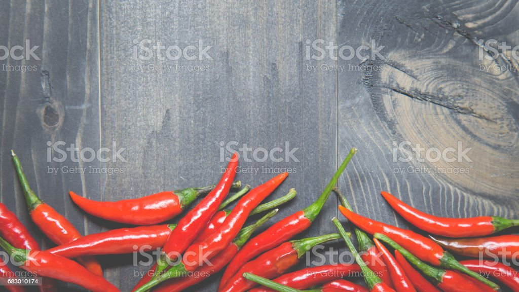 Red chili with spicy flavor on black wood background. royalty-free stock photo
