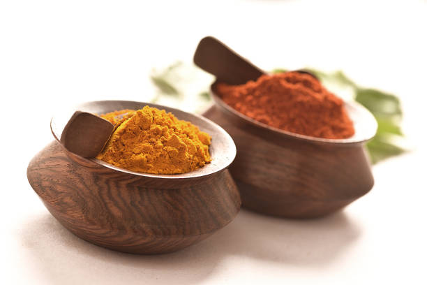 Red Chilli and Turmeric with Curry Leaves stock photo