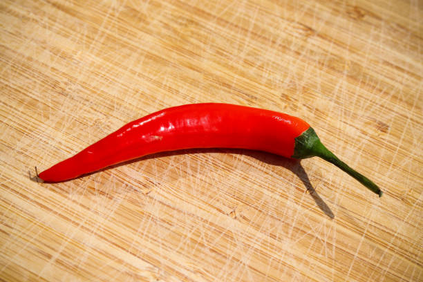 Red chilli on wooden board stock photo