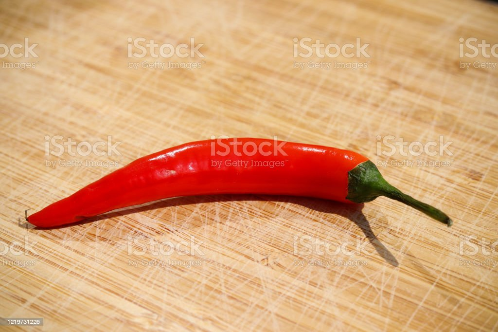 Red chilli on wooden board - Royalty-free Agriculture Stock Photo