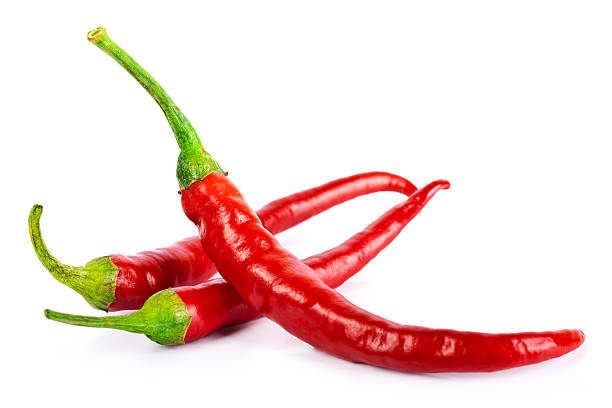 red chilli peppers isolated on white stock photo