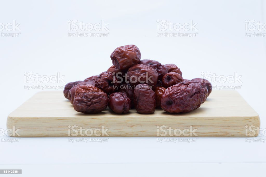 Red chinese dried jujube on wooden board stock photo