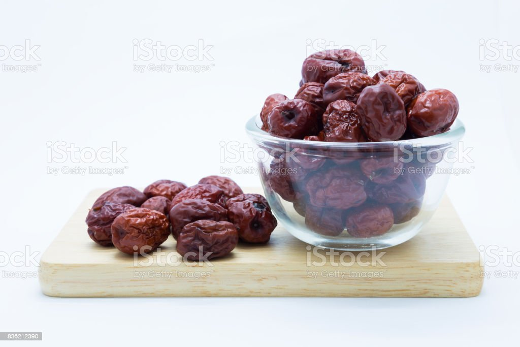 Red Chinese dry Jujube on wooden board stock photo