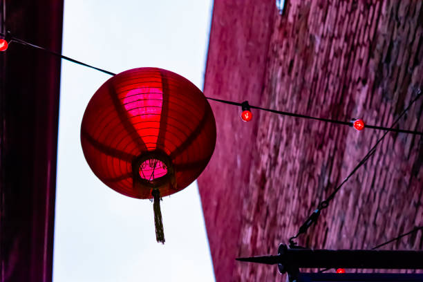 Red Chinese Lantern Hanging in Alleyway stock photo
