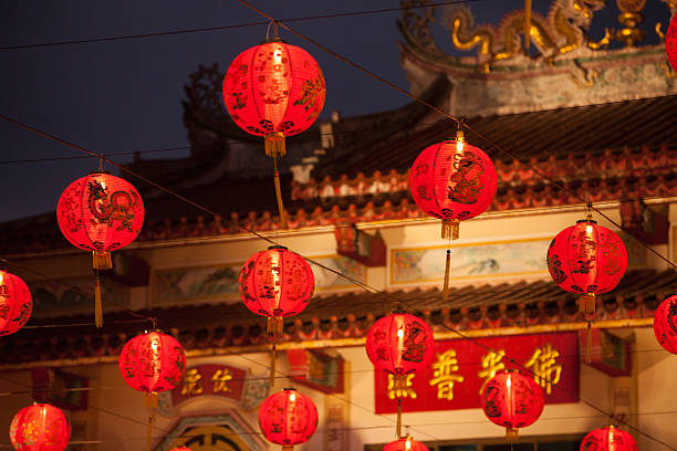 red chinese lantern in front of chinese temple. - festival delle lanterne cinesi foto e immagini stock
