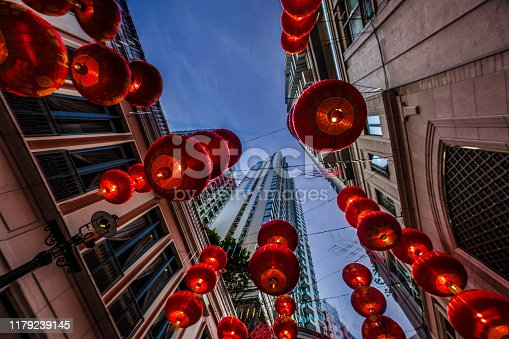 istock Red Chinese new year lanterns hanging on the street at dusk 1179239145