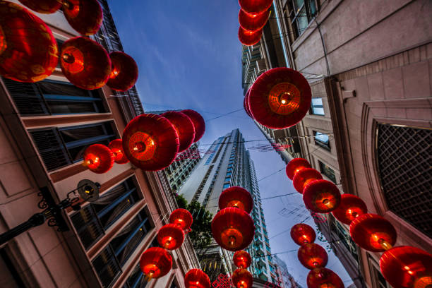Red Chinese new year lanterns hanging on the street at dusk stock photo