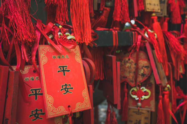 red chinese prayer charms - gradients golden ribbons imagens e fotografias de stock