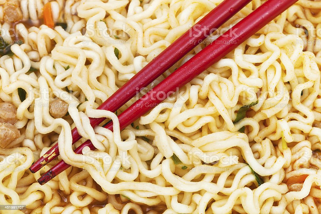 red chopsticks on cooked instant ramen royalty-free stock photo