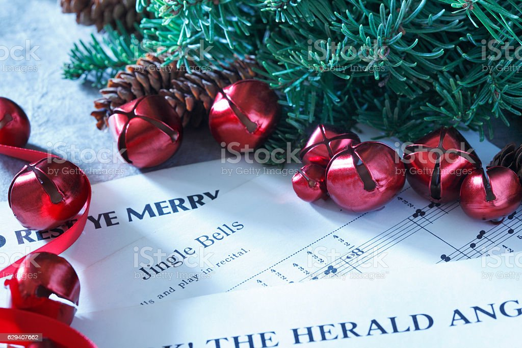 Red Chrismas Bells Surround Christmas Sheet Music stock photo