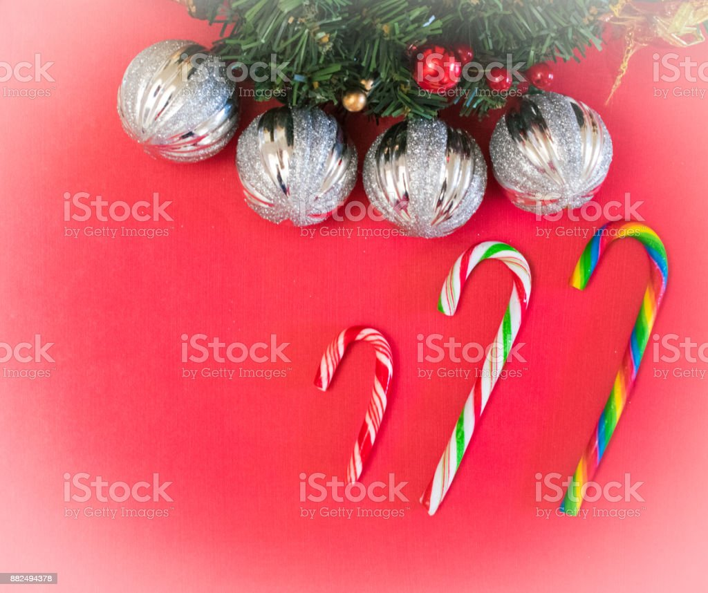 Red Christmas background with candy canes and silver ornaments stock photo