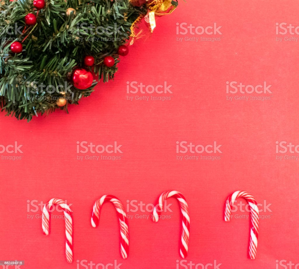 Red Christmas background with candy canes and spruce stock photo